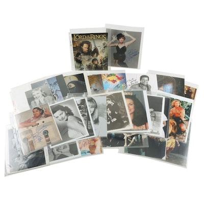 Autographed Photos of Celebrities Including Eddie Murphy and Viggo Mortensen