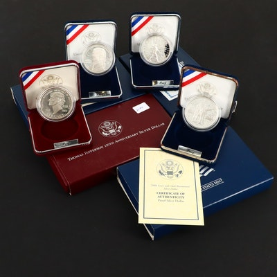 Four U.S. Commemorative Proof Silver Dollars