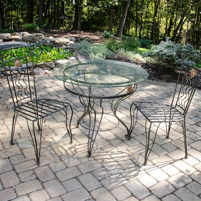 "Iron Patio Dining Set with ""Sun in Splendour"" Details"