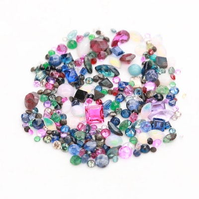 Loose 14.50 CTW Assorted Gemstones Including Opal, Garnet and Blue Sapphire