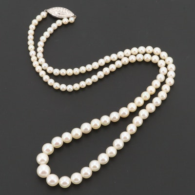 Circa 1940s Graduated Strand of Cultured Pearls and 14K White Gold Diamond Clasp