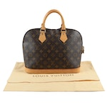 Louis Vuitton Paris Alma PM Bag in Monogram Canvas and Leather