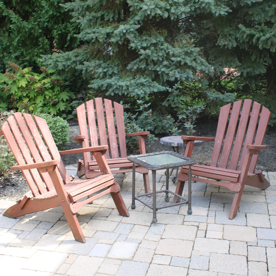 Three Wood Adirondack Chairs and Two Accent Tables