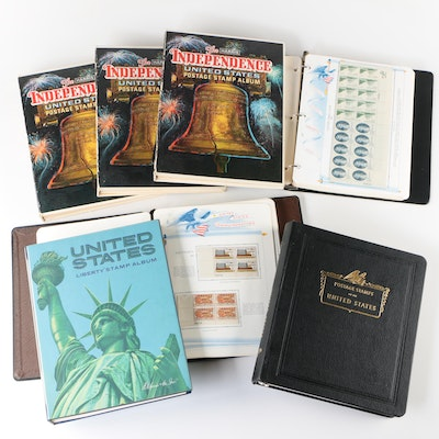 Collection of Seven U.S. Postage Stamp Albums