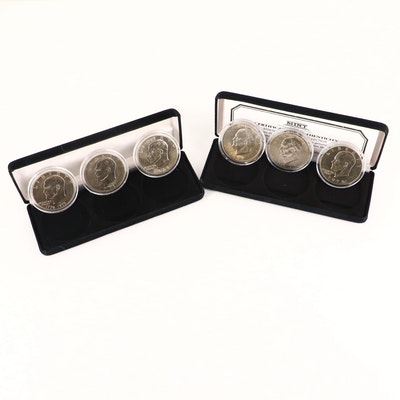 Two Three-Coin Sets of Uncirculated Eisenhower Dollars