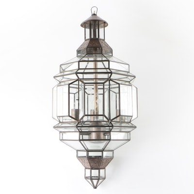 Hanging Lantern Style Light Fixture with Glass Panels and Stamped Metal Accents