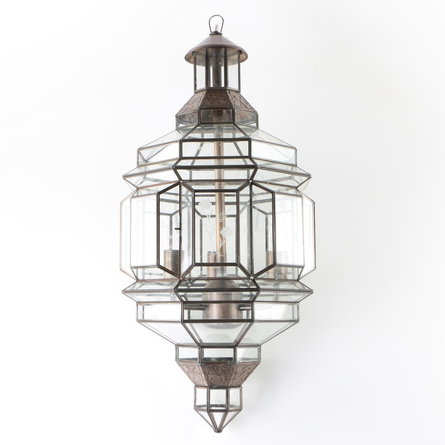 Hanging Lantern Style Light Fixture With Gl Panels And Stamped Metal Accents