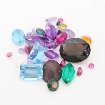 Loose 10.94 CTW Gemstone Assortment Including Topaz and Amethyst