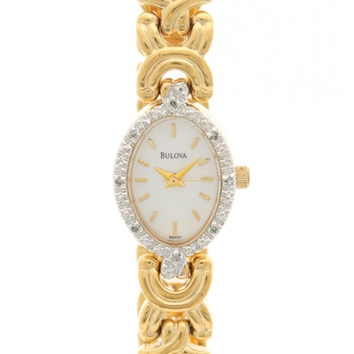 Bulova Yellow Tone Wristwatch With Diamond Bezel and Mother of Pearl Dial
