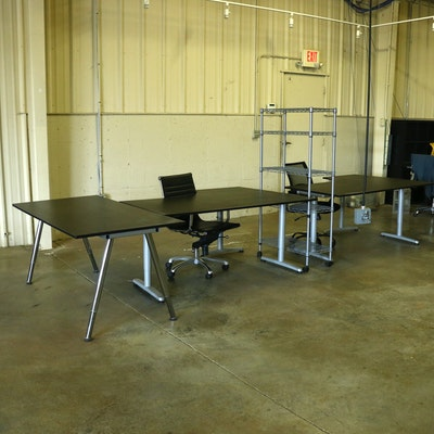 "IKEA ""Galant"" Corner Desks, Office Chairs, and Metal Rack"