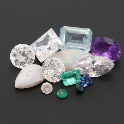 Loose 13.02 CTW Gemstone Assortment Including Topaz and Emerald