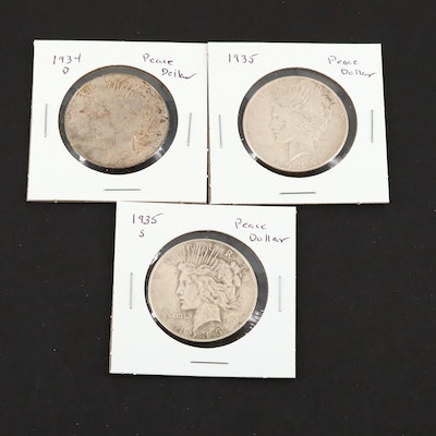 Three Silver Peace Dollars Including a 1934-D, 1935, and 1935-S