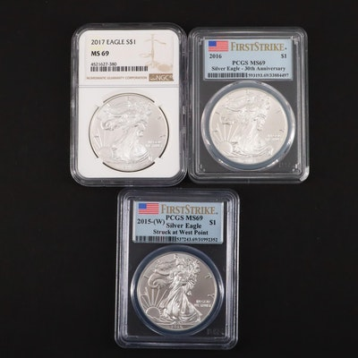 Three Graded $1 U.S. Silver Eagles Including 2015-W, 2016, and 2017