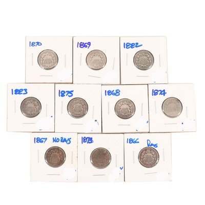 Ten Shield Nickels Featuring an 1867 With Out Rays