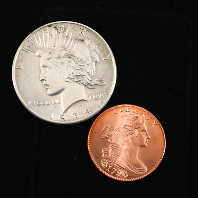 A 1934 Peace Silver Dollar and a Reproduction Large Cent