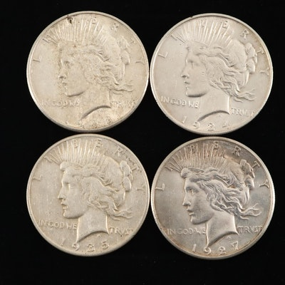 Four Silver Peace Dollars: 1927-S, 1928-S, 1934-D, and 1935