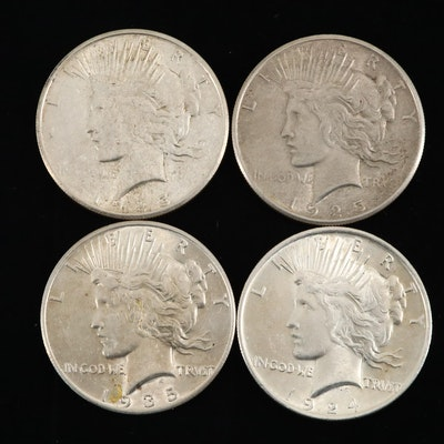 Four Silver Peace Dollars: 1924, 1925, 1925-S, and 1935