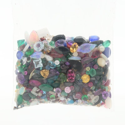 Loose Gemstone Assortment Featuring Rubies, Sapphires, and Emeralds