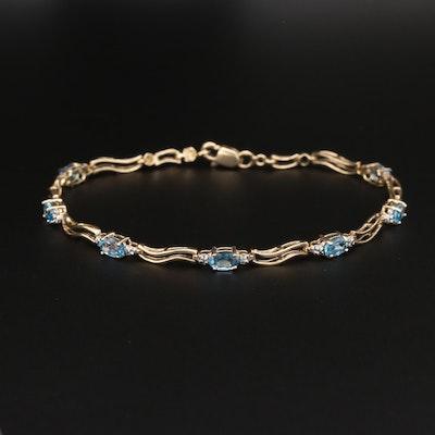 10K Yellow Gold Blue Topaz and Diamond Bracelet