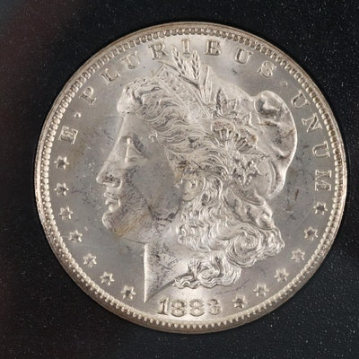 An 1883-CC Morgan Silver Dollar In a GSA Slab