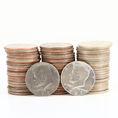 Sixty-Three JFK Half Dollar Coins
