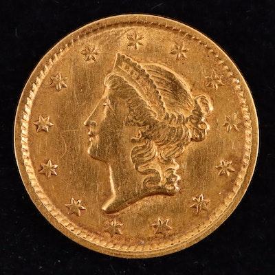 An 1851 Liberty Head Type I Gold Dollar