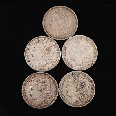 Five Silver Morgan Dollars including 1879, 1881-S, 1886-O, 1888-O, and 1897
