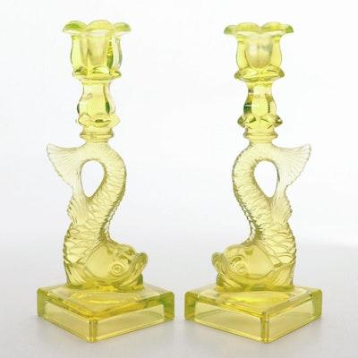 Pair of Metropolitan Museum of Art Vaseline Glass Dolphin Candlesticks