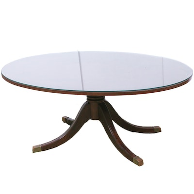 Federal Style Mahogany Finish Oval Coffee Table with Brass Accents, Contemporary