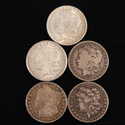 Five Silver Morgan Dollars Including 1879-S, 1880-S, 1884-O, 1890-O, and 1921-S