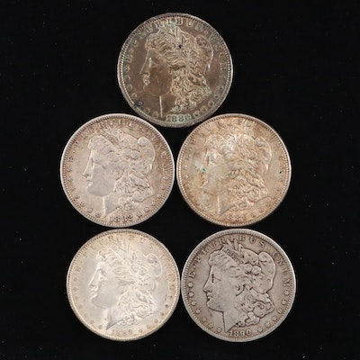 Five Silver Morgan Dollars Including 1880-O, 1886, and 1890