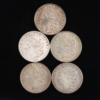 Five Silver Morgan Dollars Including 1889, 1921, and 1921-S