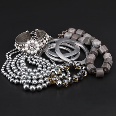 Assorted Bracelets and Necklaces with a Metal Motif