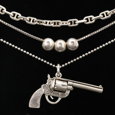 Sterling Silver Necklaces Including Cable Chain and Articulated Revolver Pendant