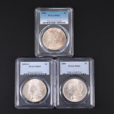 Three PCGS Graded MS63 Silver Morgan Dollars Including an 1898-O