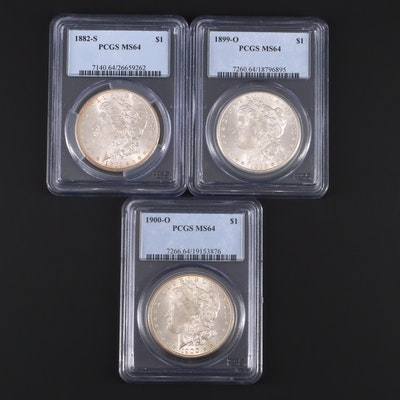 Three PCGS Graded MS64 Silver Morgan Dollars Including an 1899-O