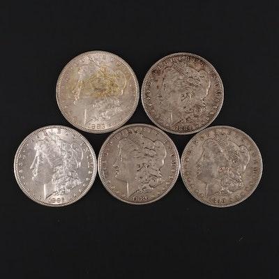 Five Silver Morgan Dollars Including 1883-O, 1884, 1885, 1886, and 1890-O