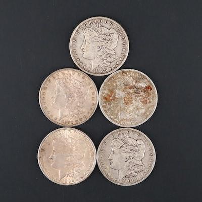 Five Silver Morgan Dollars Including 1885, 1890-S, 1896, 1896-O, and 1901-O