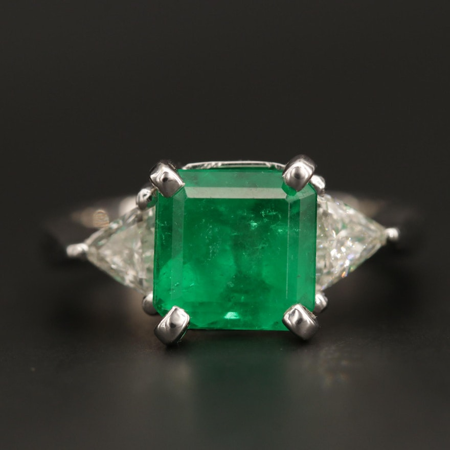14K White Gold 2.36 CT Emerald Ring Flanked by Triangle Cut Diamonds