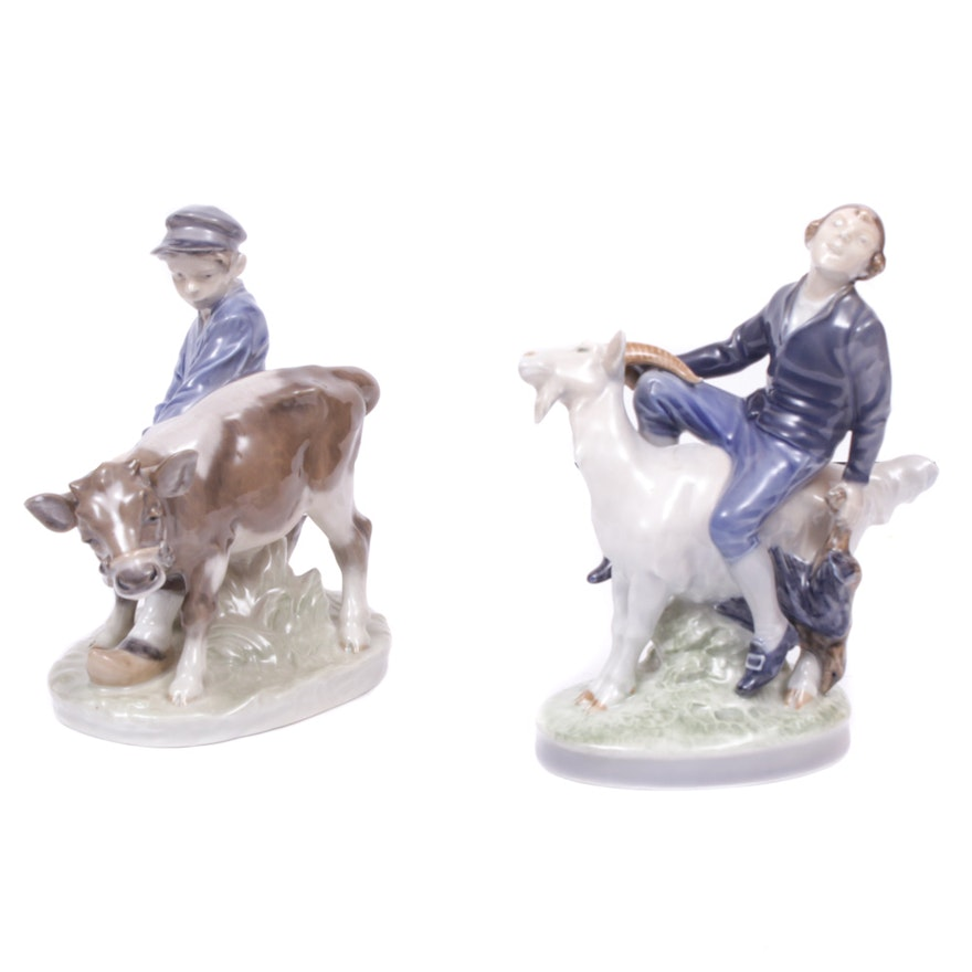 "Royal Copenhagen Porcelain Figurines ""Boy with Calf"" and ""Boy on Goat"""