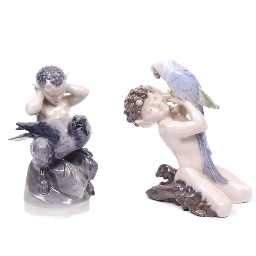 """Royal Copenhagen """"Faun with Crow"""" and """"Faun with Parrot"""" Porcelain Figurines"""