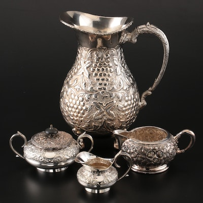 Repoussé Silver Plate Pitcher and Tableware Including Lathan & Morton