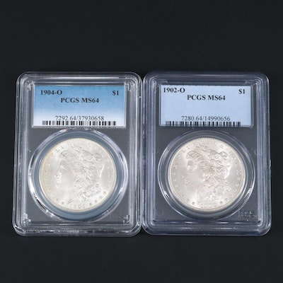 Two PCGS Graded MS64 Silver Morgan Dollars Including a 1902-O and 1904-O