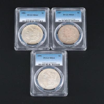 Three PCGS Graded MS64 Silver Morgan Dollars Including an 1887