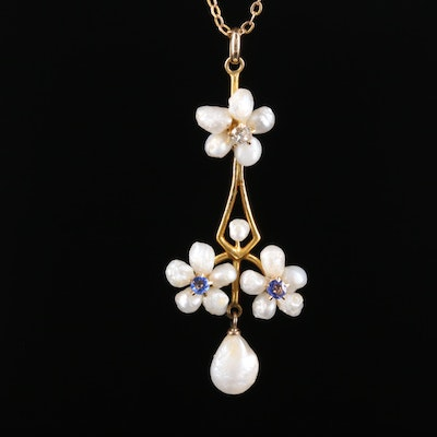 Circa 1910 10K Seed Pearl Necklace with Diamond and Garnet Accents