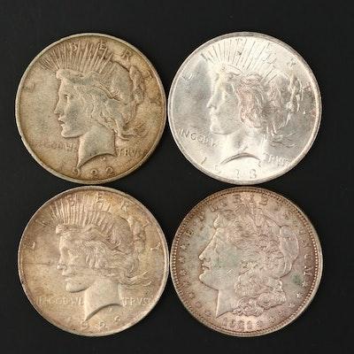 One Morgan and Three Peace Silver Dollars