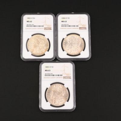 Three NGC Graded Silver Morgan Dollars Including 1883-O, 1884-O, and 1885-O
