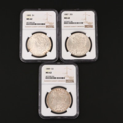 Three NGC Graded MS62 Silver Morgan Dollars Including an 1885, 1887, and 1889