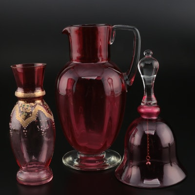 Cranberry Glass Pitcher, Enameled Vase, and Bell