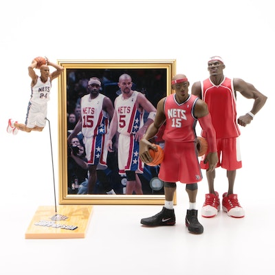 LeBron, Jefferson, and Carter Statues with a Framed Picture